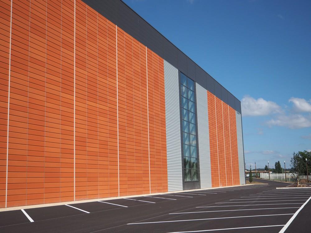 Extension du centre logistique quatro architecture - Cout batiment industriel ...